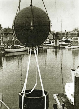 Prototype SOFAR float in Woods Hole in the late 1960s. (Photo courtesy of Tom Rossby). The sphere housing the electronics and battery has a diameter of 1m, with the transducer hanging below. See Rossby & Webb 1970.